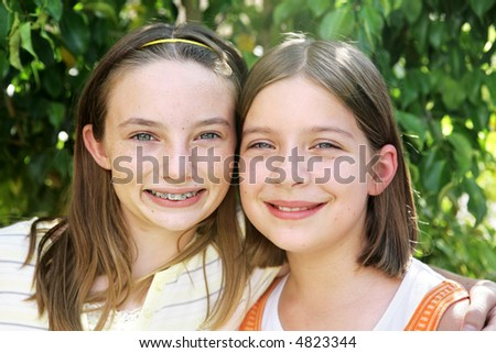 Portrait of two beautiful school girls who are best friends. - stock photo