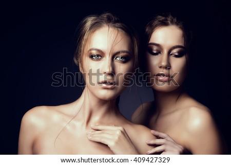 Portrait of two beautiful sensual women. - stock photo