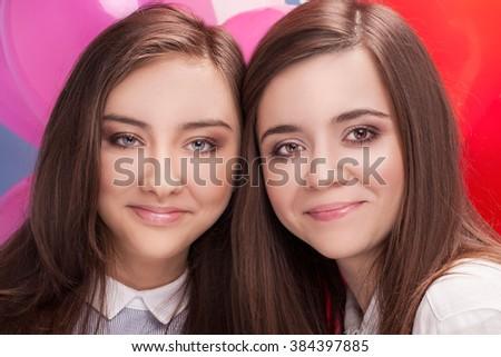Portrait of two beautiful sisters. Teenage girls. - stock photo