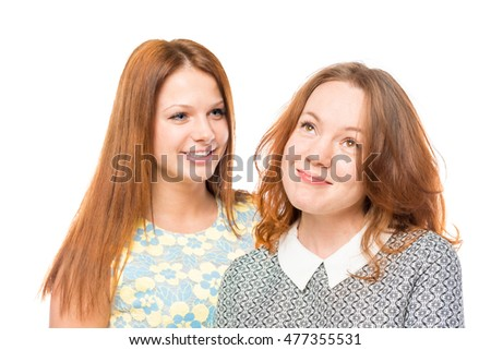 Portrait of two beautiful women friends isolated on white background