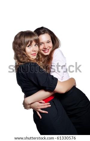 Portrait of two beautiful women on white - stock photo