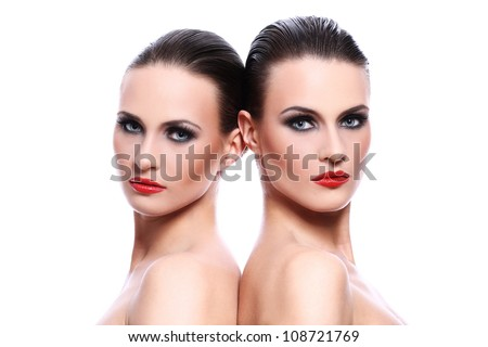 Portrait of two beautiful women over white background - stock photo