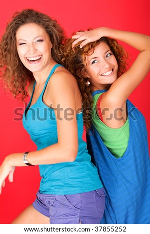 Portrait of two beautiful young women laughing together.