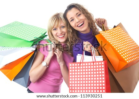 Portrait of two Beautiful young women with shopping bags - stock photo