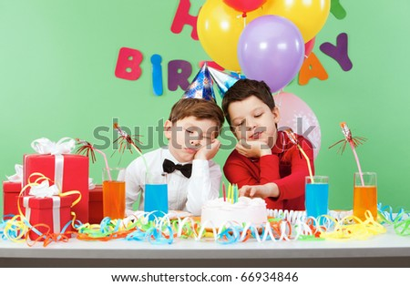 Portrait of two boys boring during birthday party - stock photo