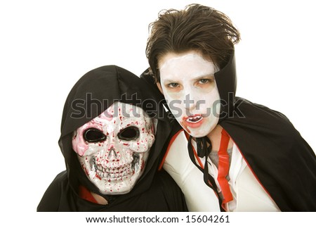 Portrait of two boys dressed in scary Halloween costumes.  Isolated on white. - stock photo