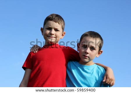 Portrait of two boys, siblings, brothers and best friends. - stock photo
