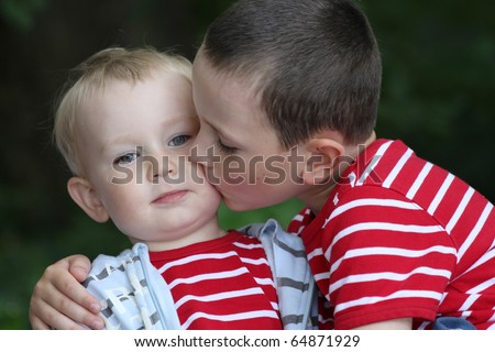Portrait of two boys, siblings, brothers and best friends � 18 month old baby boy and 6 years old child. - stock photo