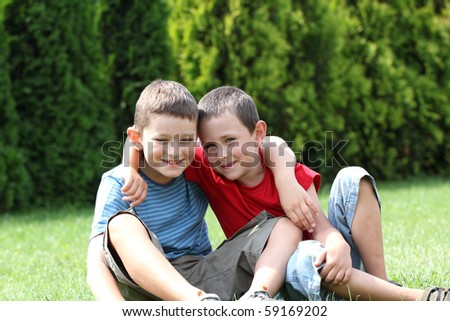 Portrait of two boys, siblings, brothers and best friends smiling. Friends hugging.