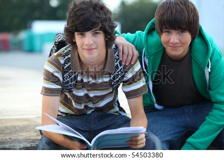 Portrait of two boys smiling - stock photo