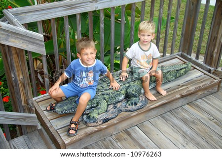 Portrait of two boys with an alligator - stock photo