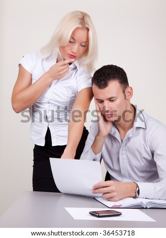 Portrait of two business people analyse report