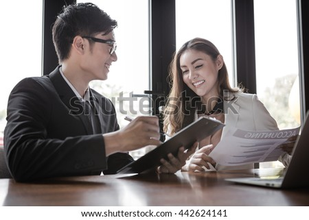 portrait of two business people discussing new project in coffee shop - stock photo