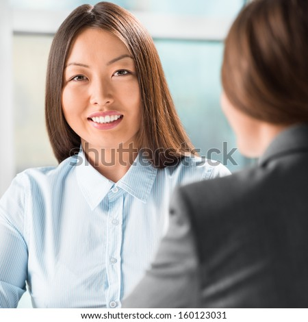 Portrait of two business women meeting at office - stock photo