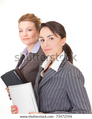 Portrait of two business women on white background - stock photo