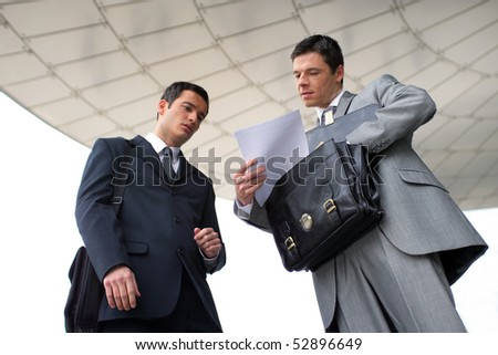 Portrait of two businessmen - stock photo