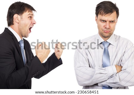 Portrait of two businessmen having a confrontation isolated on white background.Conceptual image