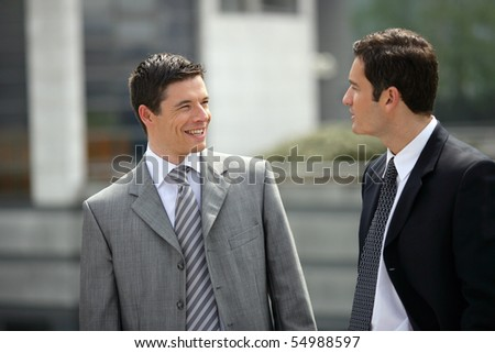 Portrait of two businessmen smiling - stock photo