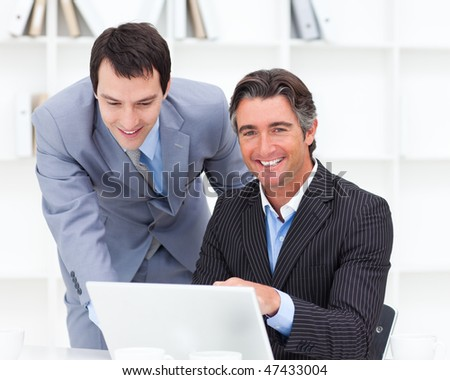 Portrait of two businessmen working at a computer in the office