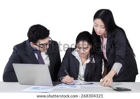 Portrait of two businesspeople on the side of their partner signing a document - stock photo