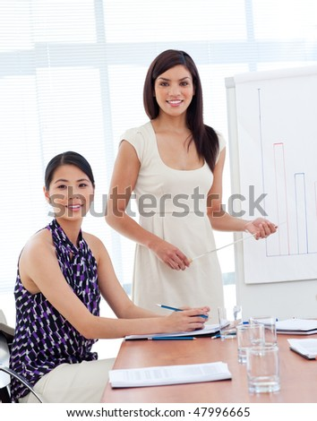 Portrait of two businesswomen at a presentation in a company - stock photo