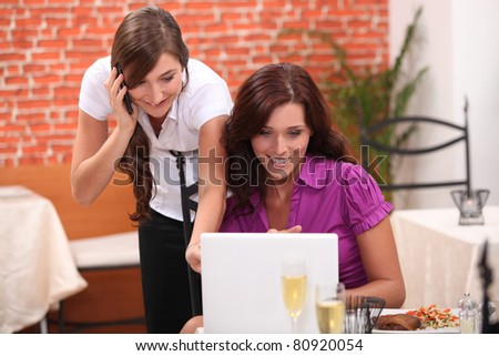 portrait of two businesswomen at restaurant