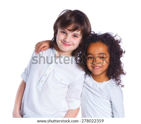 Portrait of two cheerful boy and pretty mulatto girl are standing together. Isolated on the white background - stock photo