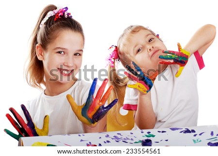 Portrait of two cheerful girls show their hands painted in bright colors