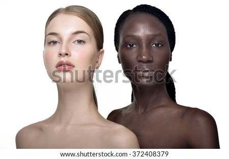 Portrait of two cheerful multiethnic women. Beautiful women, flawless skin. Diverse friends. - stock photo
