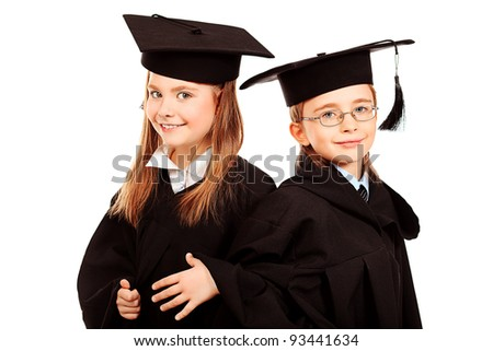 Portrait of two children in a graduation gown. Education. Isolated over white. - stock photo