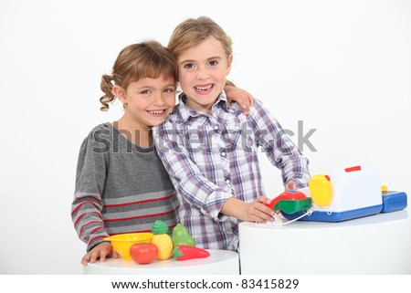 portrait of two children playing - stock photo