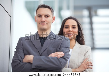 Portrait of two confident young businesspeople