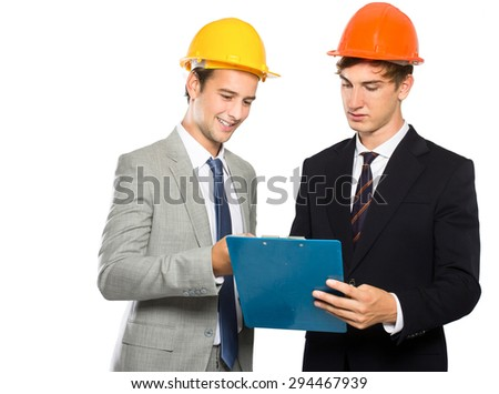 portrait of two contractors discussing about their project isolated in white