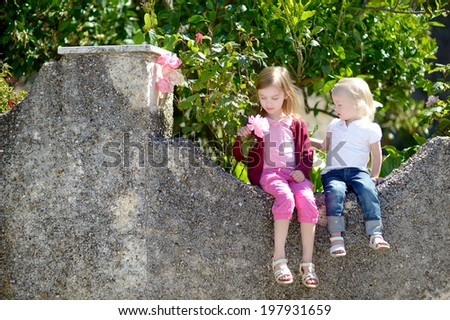 Portrait of two cute little sisters outdoors