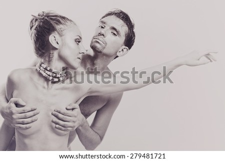 Portrait of Two embracing lovers with silver make-up - stock photo