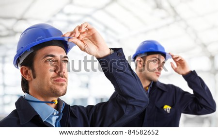 Portrait of two engineers looking at something - stock photo