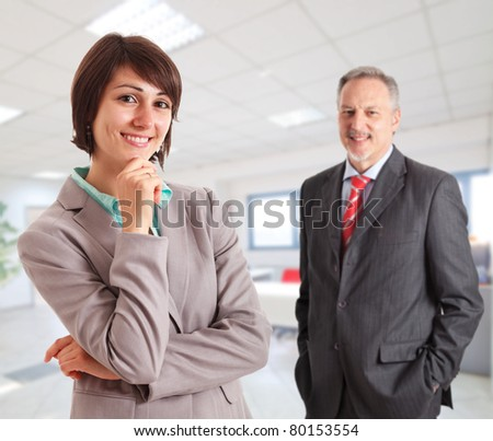 Portrait of two executives in an office environment. - stock photo