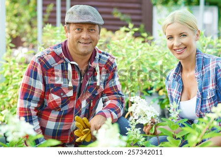 Portrait of two farmers in the garden - stock photo