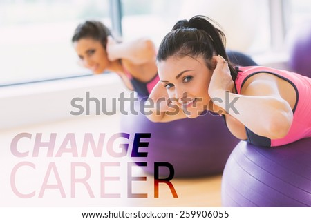 Portrait of two fit women exercising on fitness balls against change career - stock photo