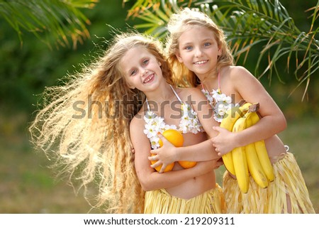 portrait of two girl in tropical style - stock photo