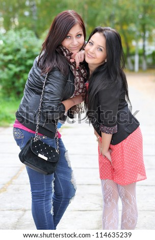 Portrait of two girls  enjoying at the park - Outdoor - stock photo