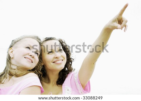 Portrait of  two girls isolated over white background - stock photo