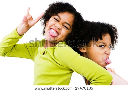 Portrait of two girls making face isolated over white - stock photo