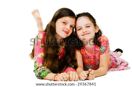 Portrait of two girls smiling and posing isolated over white - stock photo