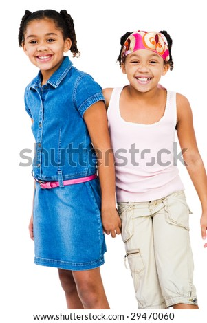 Portrait of two girls standing together isolated over white - stock photo