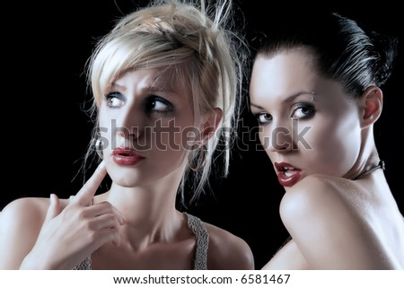 portrait of two girls with expressions - stock photo