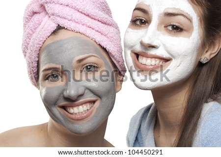 Portrait of two girls with medicated masks - stock photo