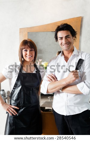 portrait of two hairstylists looking at camera - stock photo