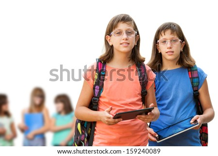 Portrait of two handicapped students with digital tablets. Isolated on white.
