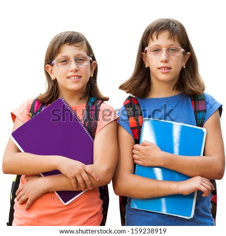 Portrait of two handicapped twin sisters with school books.Isolated on white.